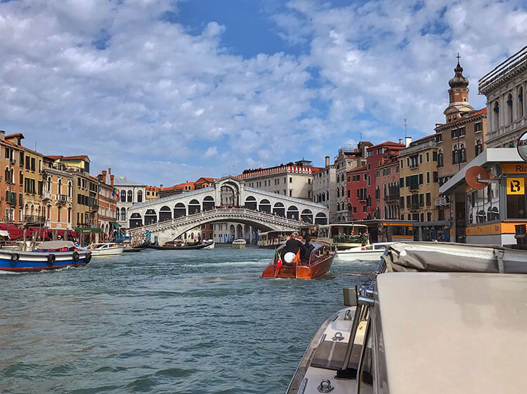 Taking a water taxi up the Grand Canal in Venice