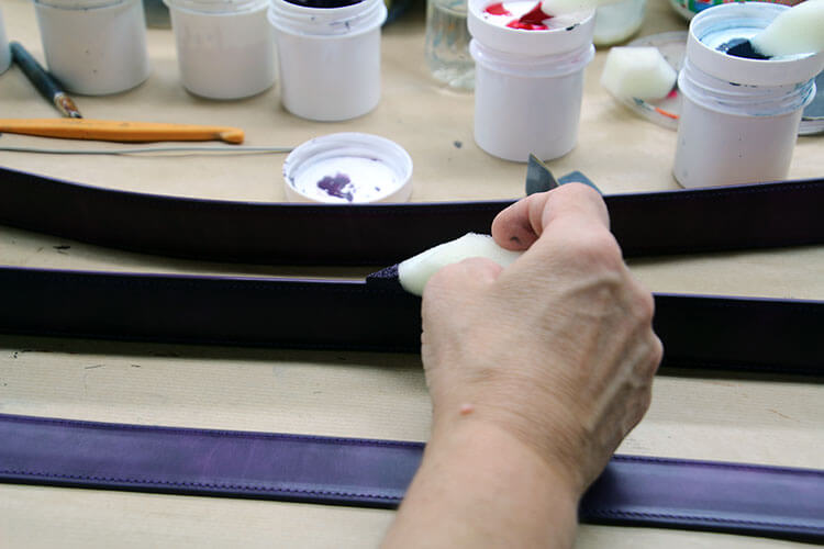 Hand dying the edges of the belt