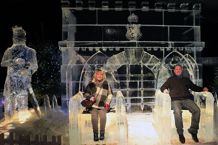Me and Tim sitting on a throne made of ice at Edinburgh's Christmas