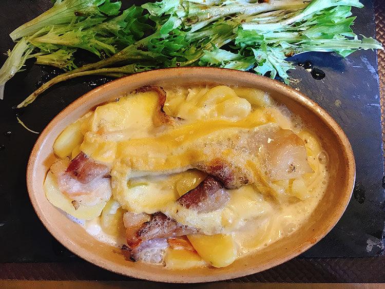 Tartiflette is a potato casserole made with jambon Bayonne and brebis