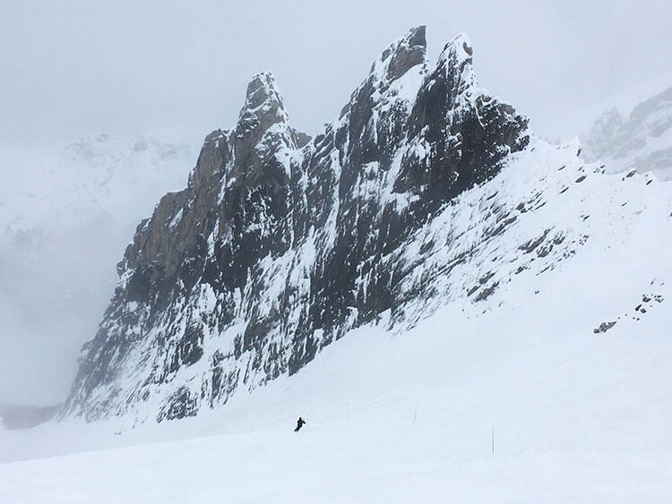 A lone skier under the jagged Pyrenees