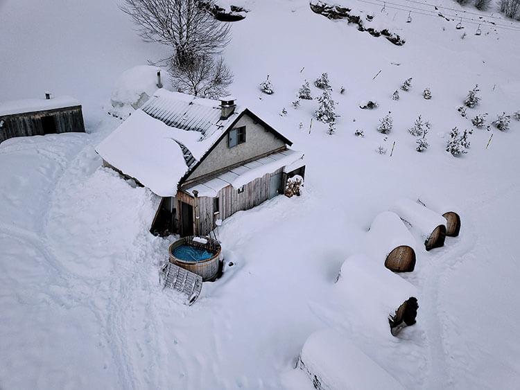 Snow pods and the jacuzzi at L'aventure Nordique village