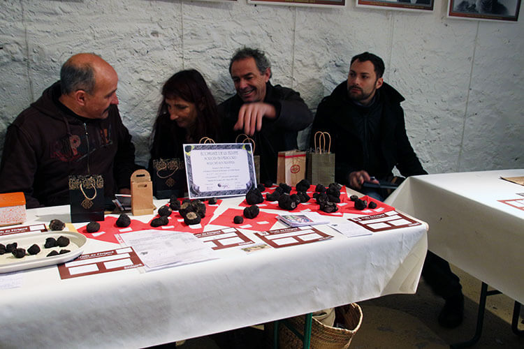 Truffle farmers set up their table at the Marche aux Truffe in Sorges