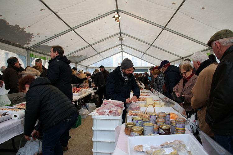 Shoppers buy foie gras and truffles at the Marche aux Truffes in Perigueux