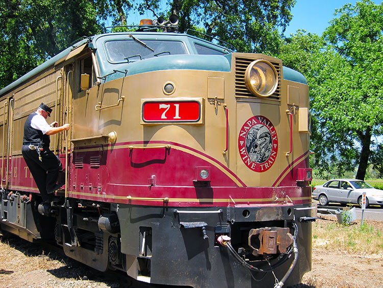 Conductor climbing aboard the Napa Valley Wine Train