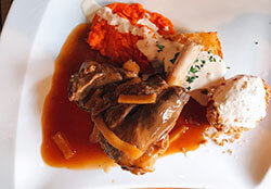 Lamb shank with sweet potato puree at Bistro du Musee