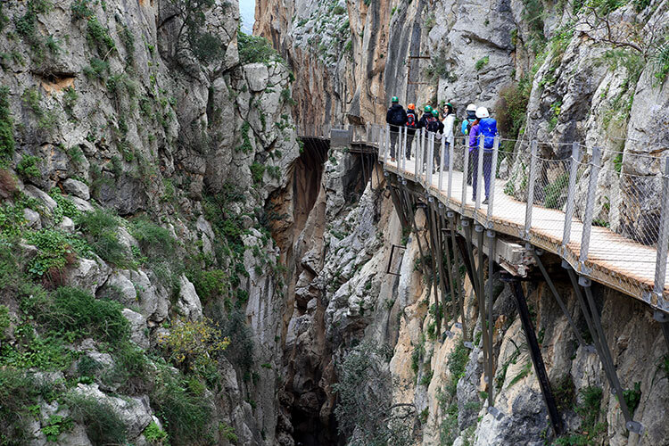 A group of hikers begins the trek along the boardwalks of Caminito del Rey