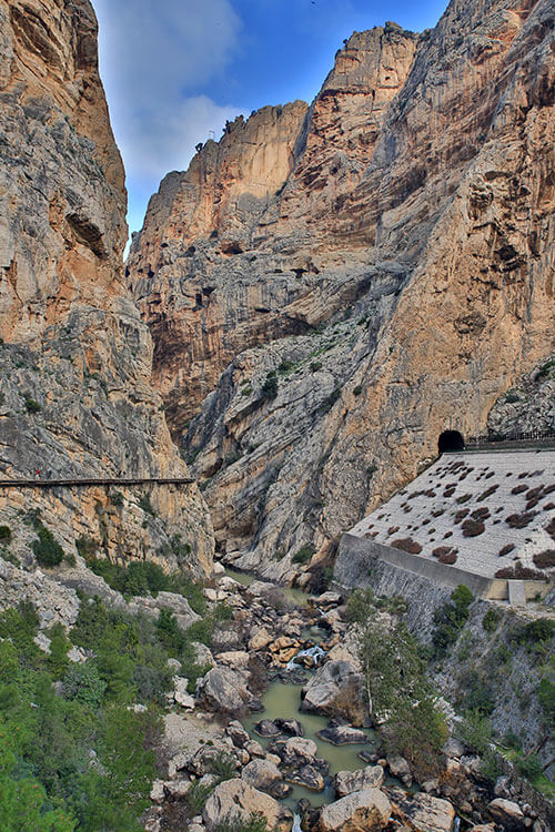 A wooden boardwalk clings to the cliffside on the Caminitio del Rey