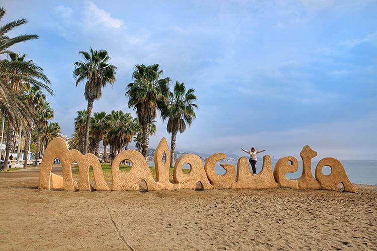 A Malagueta sign spans Malagueta Beach