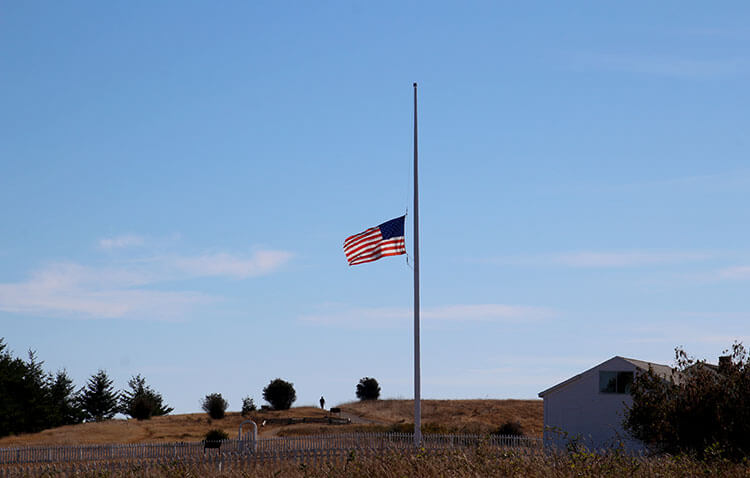 The American flag flies at half mast on September 11 at American Camp