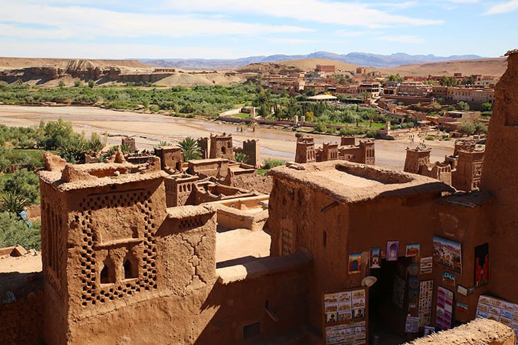 A shop sells a few paintings and trinkets to tourists in Ait-Ben-Haddou