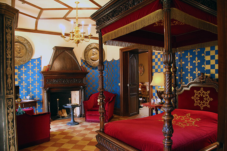 A four posted bed holds court in the Michel de Montaigne room