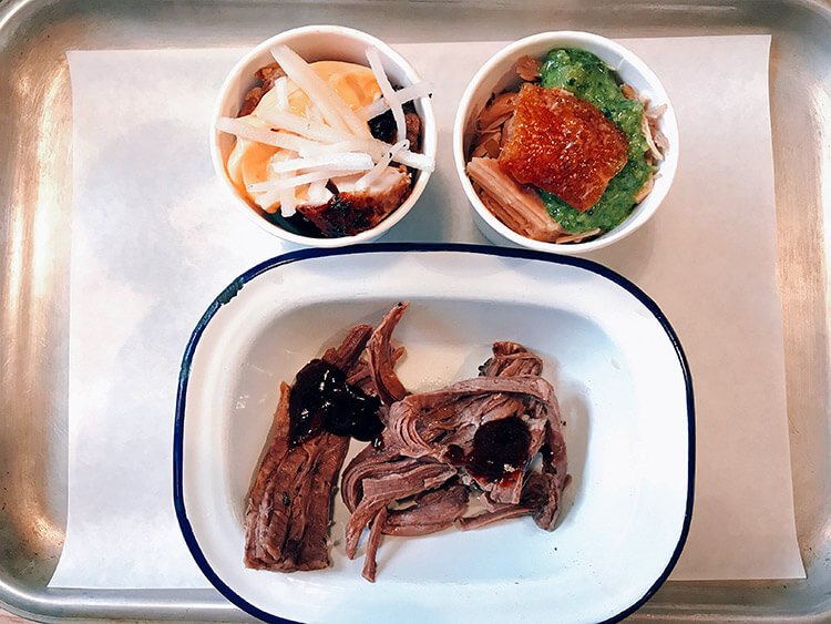 Small portions of the porchetta, honey soy chicken and brisket at Bread & Meat