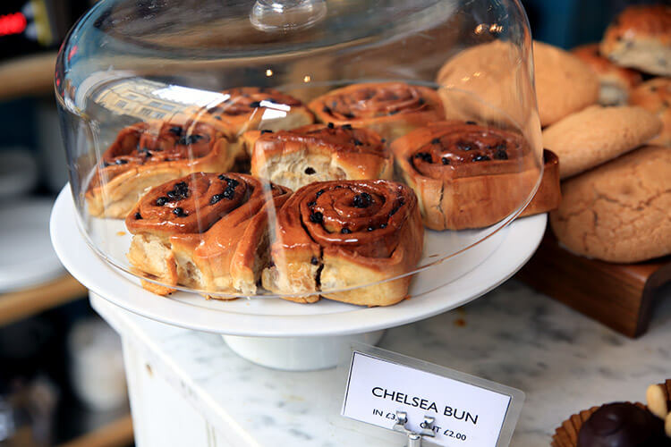 Chelsea Buns in a cake stand on the counter at Fitzbillies in Cambridge