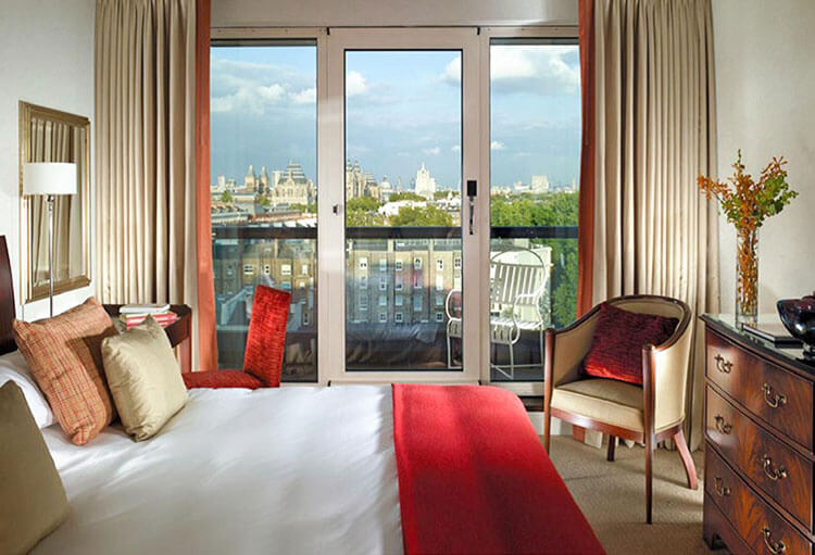 This bedroom in a serviced apartment in London has a river view