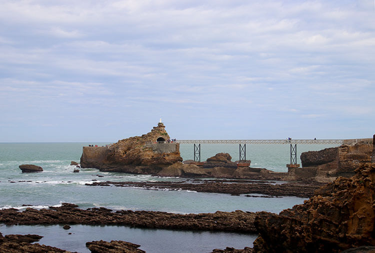 View of the Virgin Rock and metal bridge connecting it to the coast