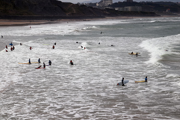 Dozens of surf students in the water at Plage de la Côtes des Basques