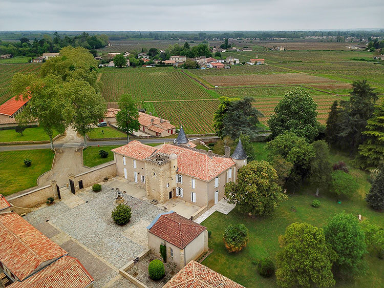 Drone aerial of Chatea Coutet and the surrounding vineyards