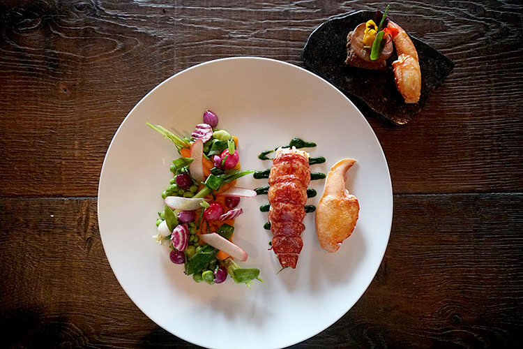 Lobster tail and claw with spring vegetables
