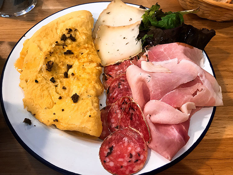 A truffle omelet with truffle ham, truffle salami and truffle cheese at Maison Balme