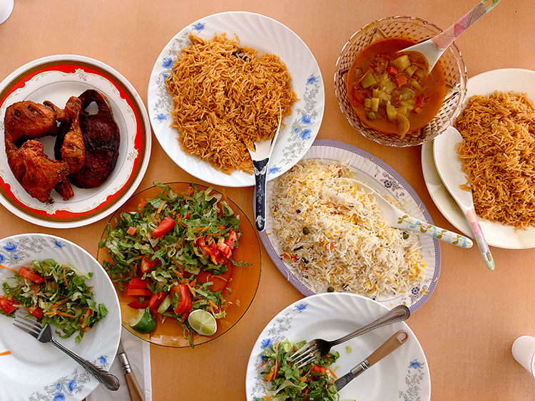 Omani chicken biryani with rice, vegetable curry and salad