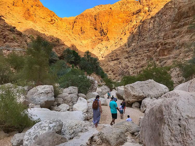 Hiking through the gorge at Wadi Shab