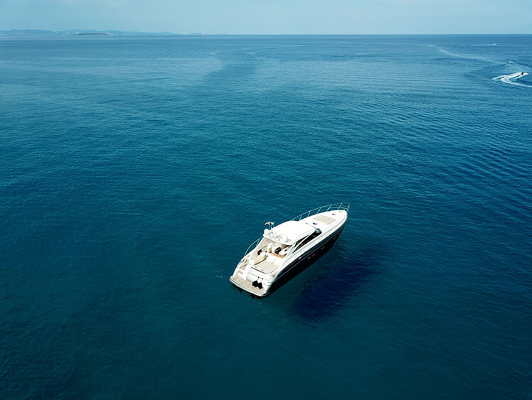 A drone shot of our yacht, Daddy Cool, anchored off of Formentera