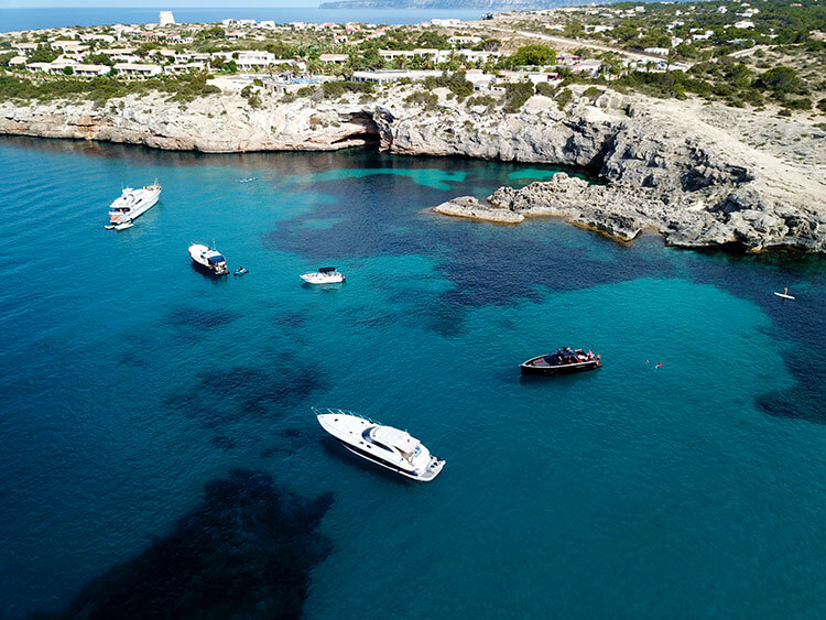 Yachts anchored off of Formentera shot with a drone