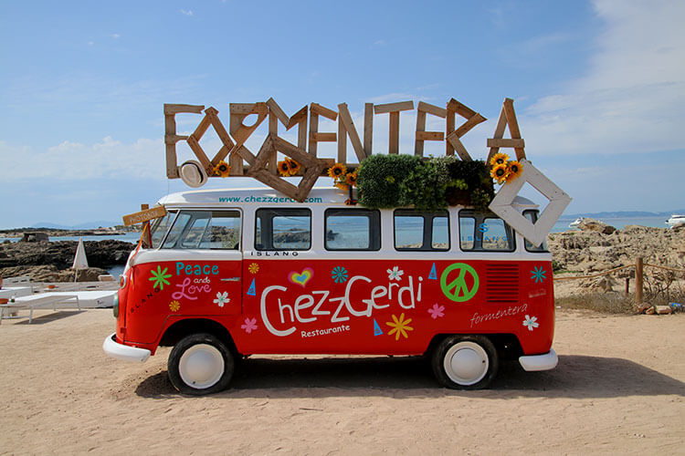 A red VW bus turned in to an Instagram photo booth at Chezz Gerdi on Formentera