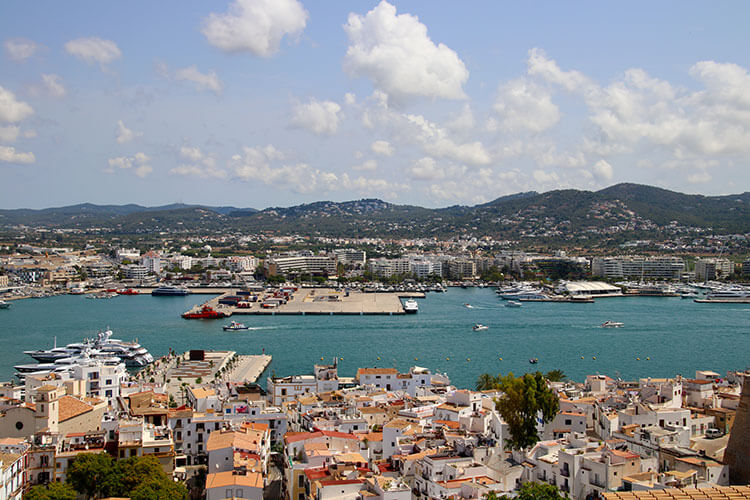 The view over the port with the red tiled houses below from the cathedral of Dalt Vila