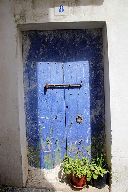 An old blue wooden door in Dalt Vila