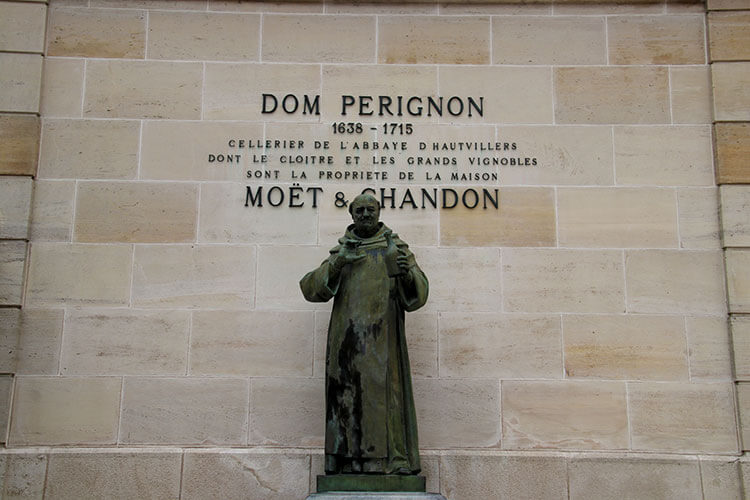 A statue of Dom Pérignon at the entrance to Moet & Chandon