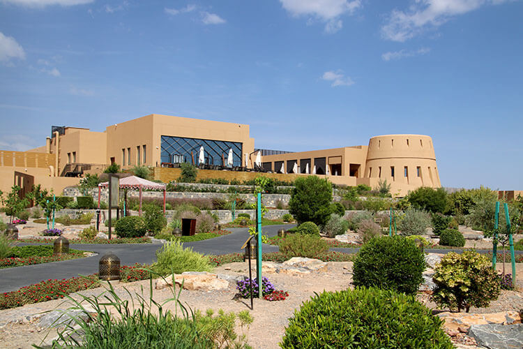 The main building of the resort is designed to look like an Omani fort with a tower