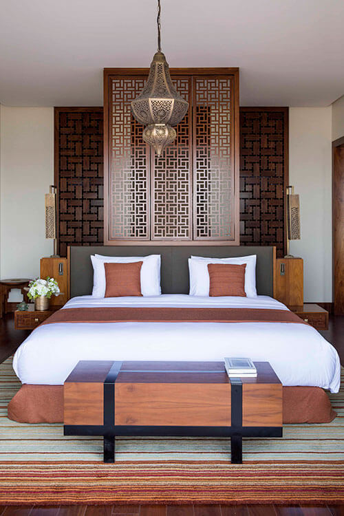 The bedroom has design touches created from Omani forts like the Omani lamp and wooden screen behind the bed