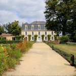 A long paved walkway leads to the main chateau and is lined with beds of marigolds