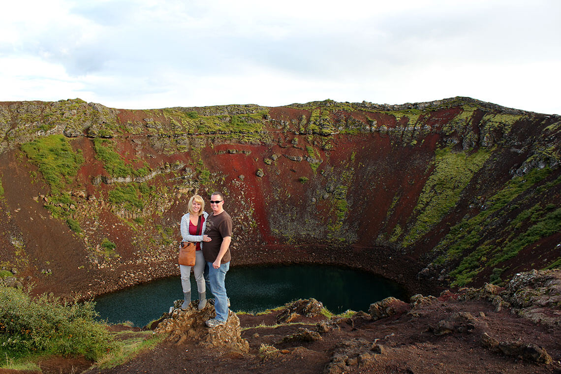 Jennifer and Tim posing on the rim of the Kerio crater on Iceland's Golden Circle