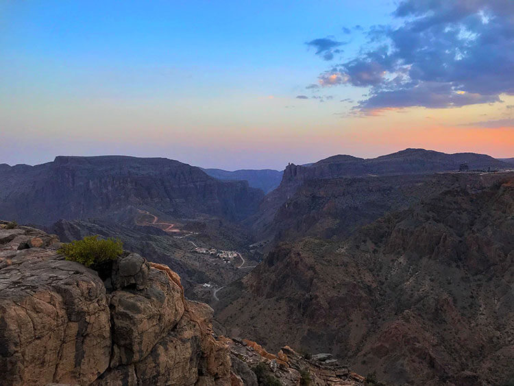 Sunset turns the sky orange and violet at Diana's Point in Jebel Akhdar