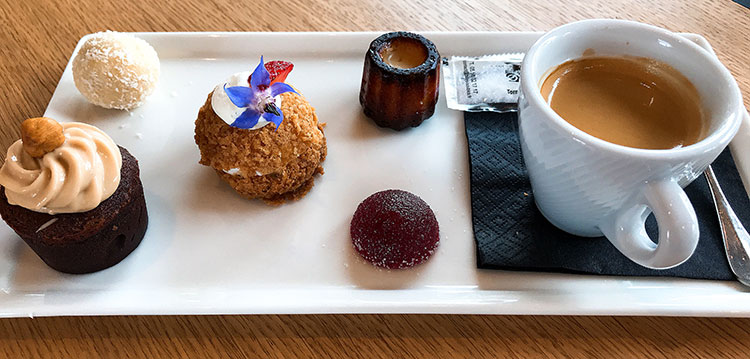 Cafe gourmand with an espresso and four mini desserts at La Chapelle