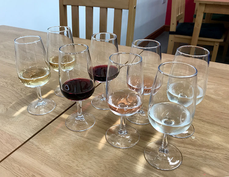A flight of Pant Du's range of wines plus their spring water to taste in their tasting room