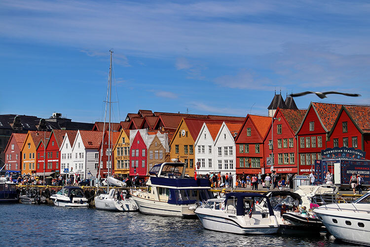 The famous line of red, yellow and white facades of Bryggen Wharf that face the pier