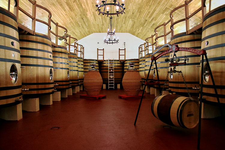 Wooden vats are used in the winery for fermenting the wine at Château Fombrauge