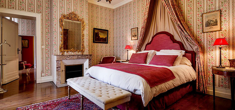The Promesse suite at Château Fombrague is decorate in florals and shades of Bordeaux