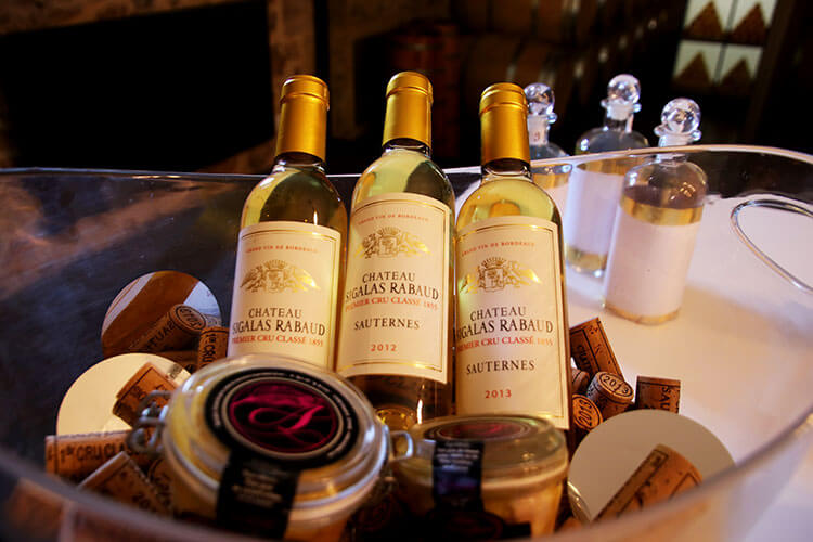Bottles of Château Sigalas Rabaud and foie gras for sale in the boutique