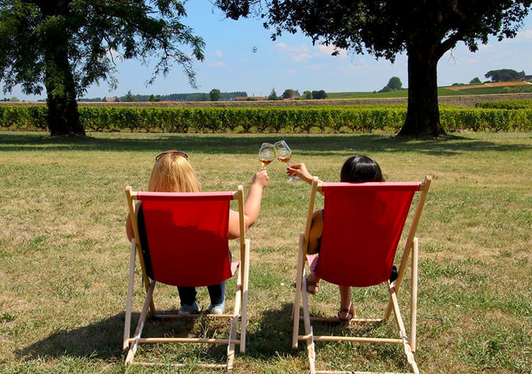 Jennifer and a friend enjoying wine on the terrasse at Château Sigalas Rabaud