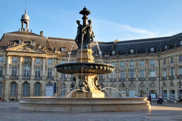The Fountain of the Three Graces stands in the center of Place de la Bourse