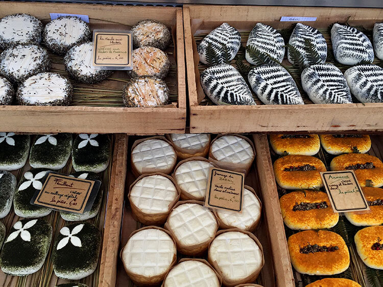 Various kinds of goat cheese with herbs at Marché du Quais