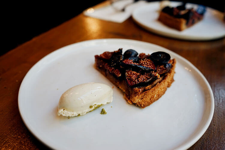 A slice of fig tart with ice cream at Abri