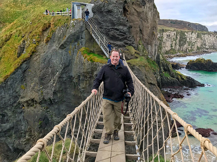 Tim halfway across the Carrick-a-Rede rope bridge