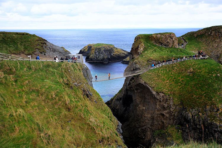 The Carrick-a-Rede rope bridge viewed from a viewpoint on the mainland