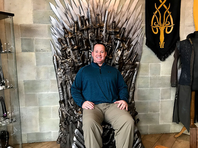 Tim sitting on a Game of Thrones throne in a special memorabilia room at the Fullerton Arms